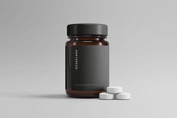 带有药丸棕色透明玻璃药瓶包装设计样机模板 Medicine Bottle with Pills Mockup